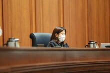 chief sits at bench with mask on and social distancing